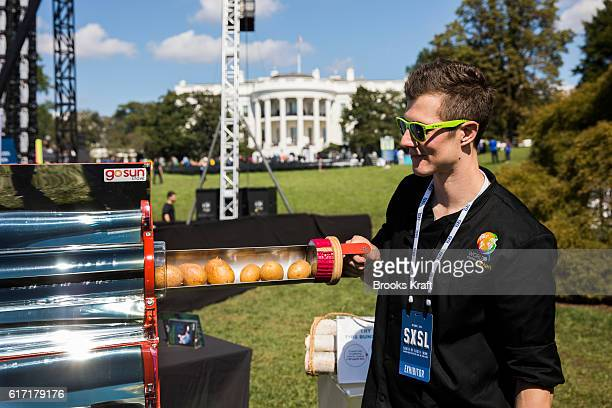Kevin Holst of World Central Kitchen uses a solar oven to cook potatoes at the 'South By South Lawn' SXSL festival on October 3 2016 in Washington DC...