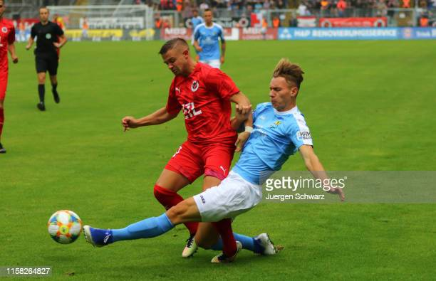 Kevin Holzweiler of Cologne and Erik Tallig of Chemnitz compete during the 3. Liga match between FC Viktoria Koeln and Chemnitzer FC at Sportpark...