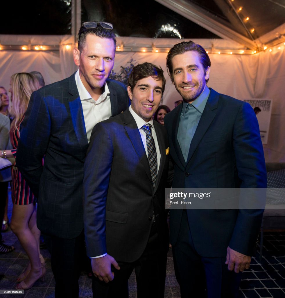 Kevin Horst, from left, Boston Marathon bombing survivor Jeff Bauman and actor Jake Gyllenhaal at the after party following the Boston Premiere of STRONGER at Spaulding Rehab Center on September 12, 2017 in Charlestown, Massachusetts.