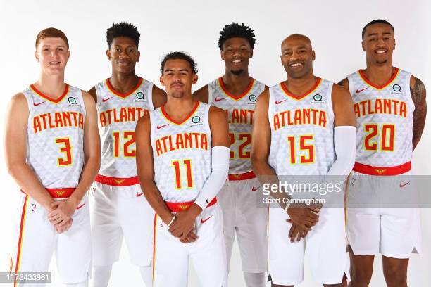 Kevin Huerter, De'Andre Hunter, Trae Young, Cam Reddish, Vince Carter and John Collins of the Atlanta Hawks pose for a portrait during media day on...