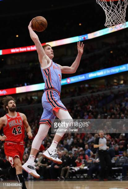 Kevin Huerter of the Atlanta Hawks goes up for a dunk past Robin Lopez of the Chicago Bulls at the United Center on March 03 2019 in Chicago Illinois...