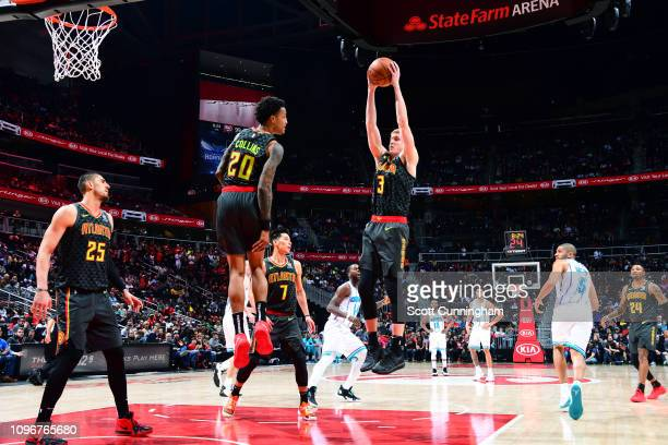 Kevin Huerter of the Atlanta Hawks rebounds the ball against the Charlotte Hornets on February 9 2019 at State Farm Arena in Atlanta Georgia NOTE TO...