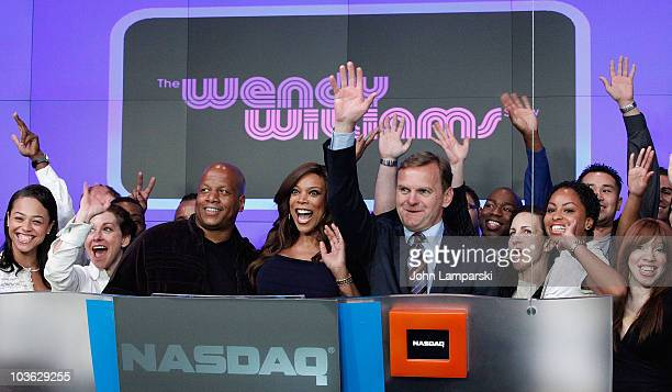 Kevin Hunter Wendy Williams and Bruce Oust ring the opening bell at the NASDAQ MarketSite on August 25 2010 in New York City
