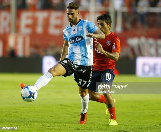 Kevin Itabel of Atletico Rafaela fights for the ball with Walter Erviti of Independiente during a match between Independiente and Atletico de Rafaela...
