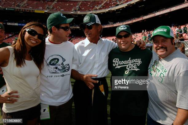 Kevin James and Adam Sandler meet with former New York Jets star Joe Namath when they attend the New York Jets vs New England Patriots game at The...