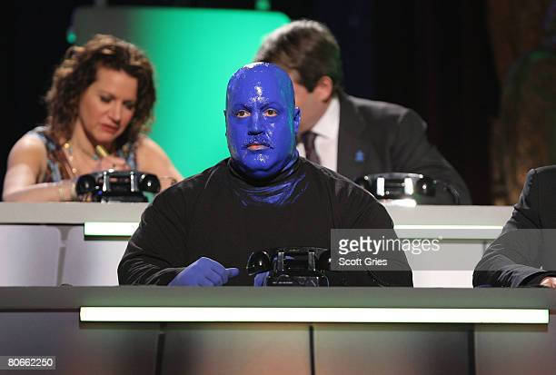 Kevin James answers phones on stage dressed as a member of the Blue Man Group during the Night of Too Many Stars An Overbooked Benefit for Autism...