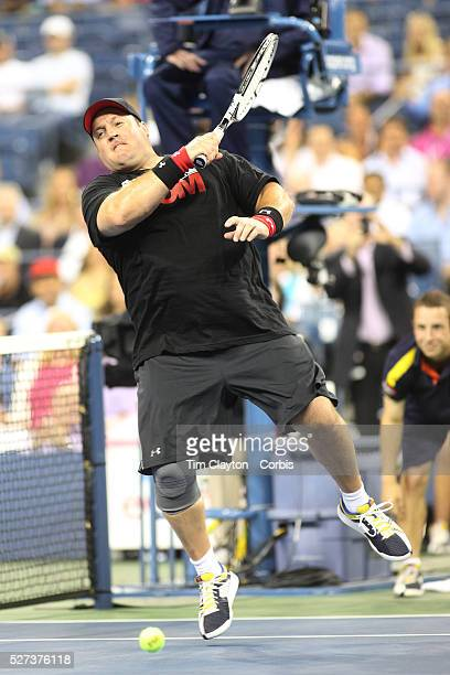 Kevin James in action during the exhibition tennis double match between John McEnroe and Adam Sandler and Jim Courier and Kevin James during the US...