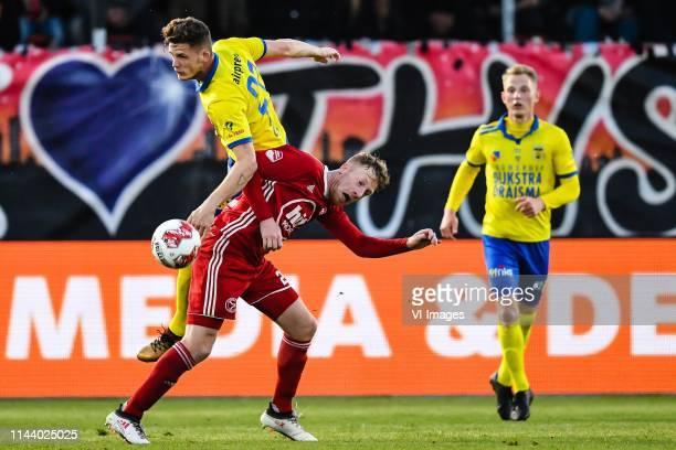 Kevin Jansen of SC Cambuur Youri Loen of Almere City FC Andrejs Ciganiks of SC Cambuur during the Dutch Keuken Kampioen Divisie play off match...
