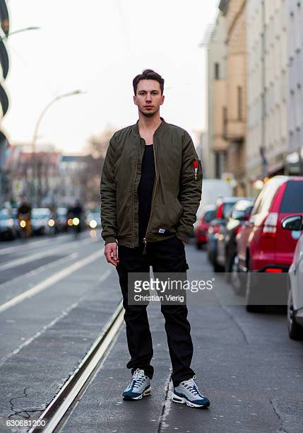 Kevin Jasionowski wearing an olive bomber jacket black pants grey navy sneakers on December 30 2016 in Berlin Germany