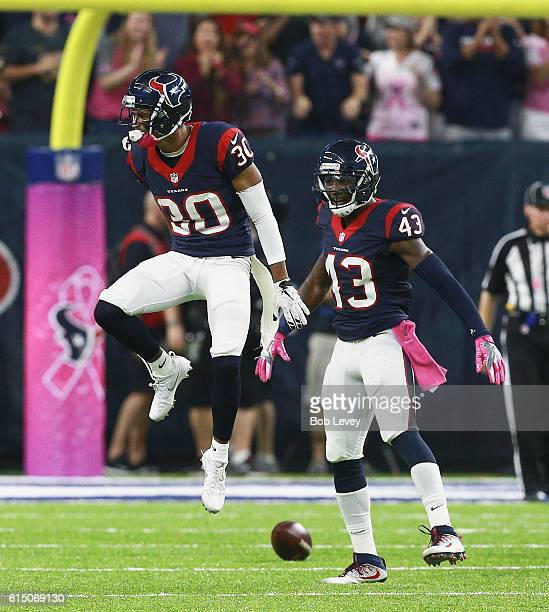 Kevin Johnson of the Houston Texans and Braxton Miller celebrate after a defensive stop against the Indianapolis Colts in the first half at NRG...