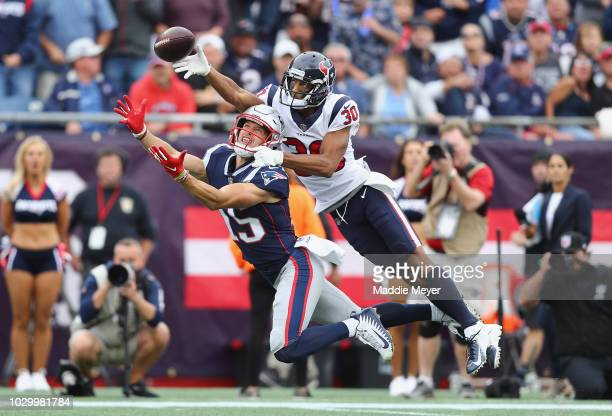 Kevin Johnson of the Houston Texans deflects a pass intended for Chris Hogan of the New England Patriots during the second half at Gillette Stadium...