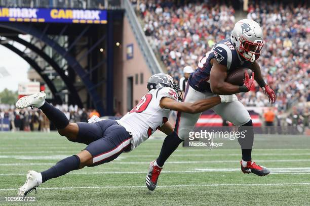 Kevin Johnson of the Houston Texans is unable to tackle James White of the New England Patriots as he runs with the ball on his way to scoring a...