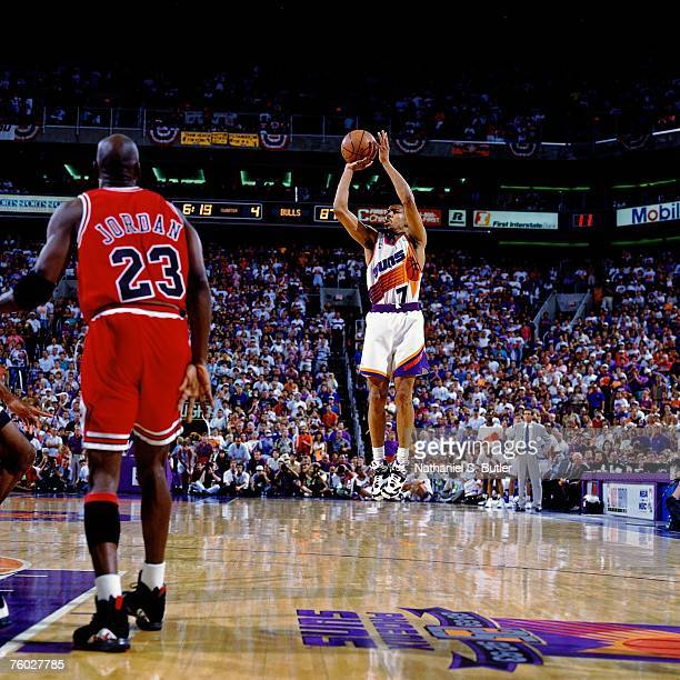 Kevin Johnson of the Phoenix Suns attempts a shot against Michael Jordan of the Chicago Bulls in Game Six of the 1993 NBA Finals on June 20 1993 at...