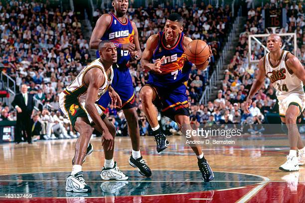 Kevin Johnson of the Phoenix Suns dribbles the ball against the Seattle Supersonics during Game Five of the Western Conference Quarterfinals as part...