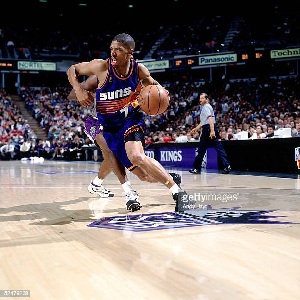 Kevin Johnson of the Phoenix Suns drives to the basket against the Sacramento Kings on December 6 1996 at Arco Arena in Sacramento California NOTE TO...