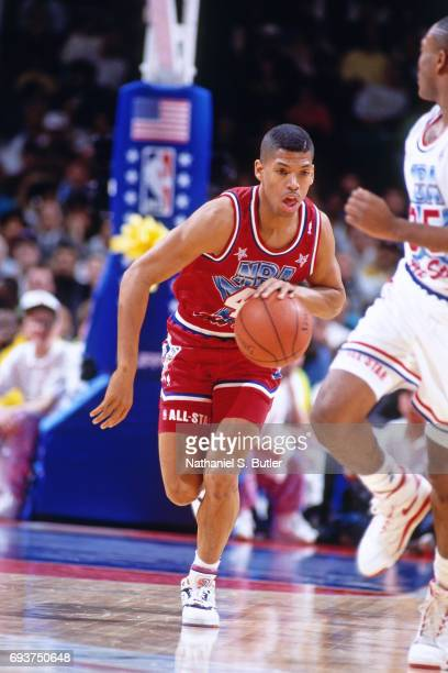 Kevin Johnson of the Phoenix Suns handles the ball during the 1991 NBA AllStar Game on February 10 1991 at the Charlotte Coliseum in Charlotte North...