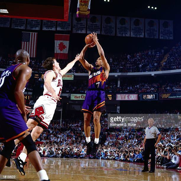 Kevin Johnson of the Phoenix Suns takes a jumper against the Chicago Bulls during Game Five of the 1993 NBA Championship Finals at Chicago Stadium on...