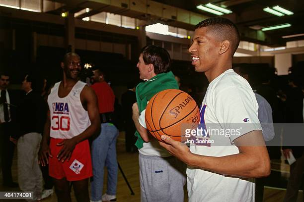 Kevin Johnson of the Western Conference AllStars laughs during NBA AllStar Practice as part of the 1991 All Star Weekend on February 9 1991 at the...
