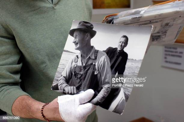 Kevin Johnson photo archivist for the Penobscot Marine Museum holds Kosti Ruohomaa's c 1950 photograph of Andrew Wyeth right and Ralph Cline a...