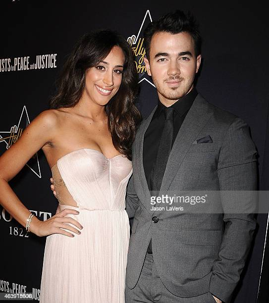 Kevin Jonas and Danielle Jonas attend the Hollywood Domino annual preOscar charity soiree at Sunset Tower Hotel on February 19 2015 in West Hollywood...