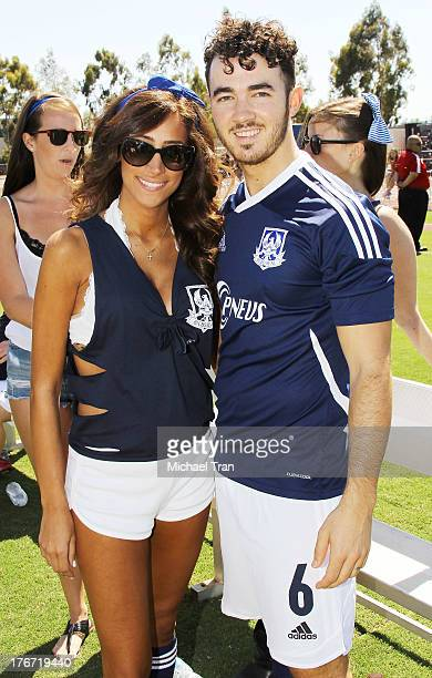 Kevin Jonas and Danielle Jonas attend The Jonas Brothers host a charity soccer match held at StubHub Center track and field on August 17 2013 in Los...