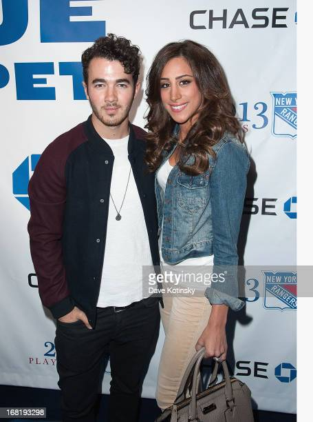 Kevin Jonas and Danielle Jonas attends the Washington Capitals vs New York Rangers 2013 Playoff Game Three at Madison Square Garden on May 6 2013 in...