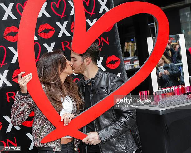 Kevin Jonas and Danielle Jonas kick off National Lover's Day at the Revlon Love is On popup shop in Times Square on April 23 2015 in New York City