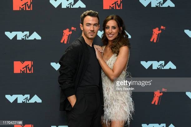 Kevin Jonas and Danielle Jonas pose in the Press Room during the 2019 MTV Video Music Awards at Prudential Center on August 26 2019 in Newark New...
