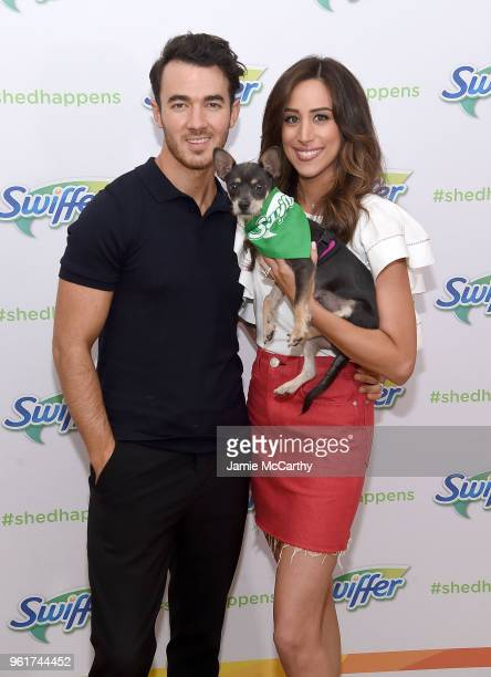 Kevin Jonas and Danielle Jonas pose with an adoptable puppy to promote Pet Adoption During National Pet Month at Home Studios on May 23 2018 in New...