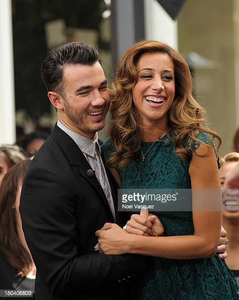 Kevin Jonas and Danielle Jonas visit Extra at The Grove on August 16 2012 in Los Angeles California