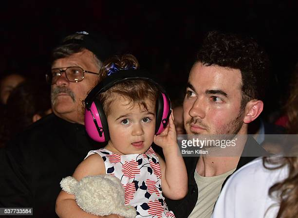 Kevin Jonas and daughter Alena Rose Jonas attend the DNCE performance during Selena Gomez in concert at The Prudential Center on June 2 2016 in...
