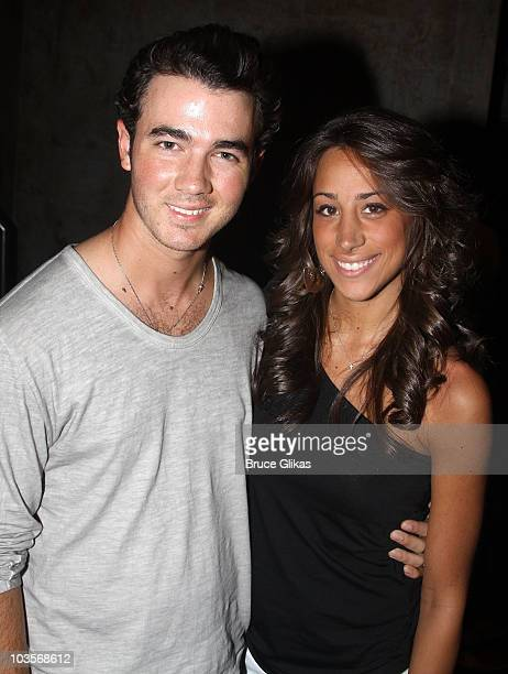 Kevin Jonas and his wife Danielle Deleasa Jonas pose backstage at the musical American Idiot on Broadway at The St James Theater on August 23 2010 in...