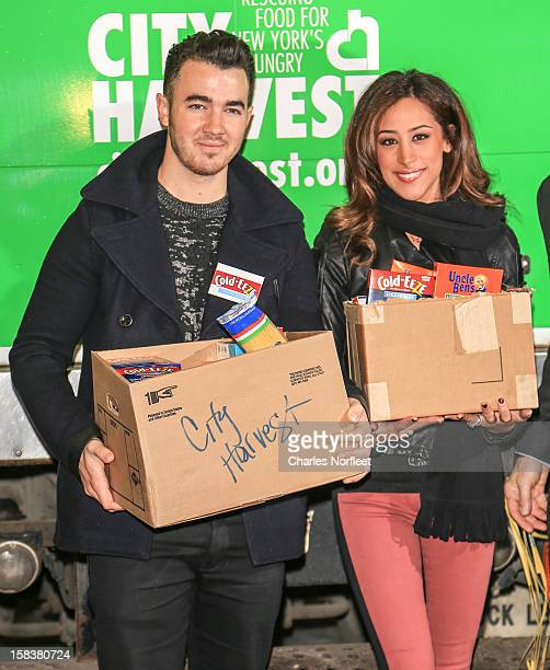 Kevin Jonas and his wife Danielle Jonas attend the City Harvest Holiday Season Food Drive at FDNY Station Lexington 3rd on December 14 2012 in New...