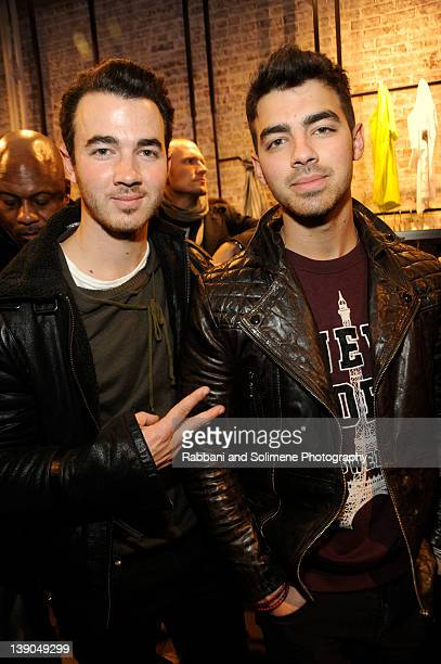 Kevin Jonas and Joe Jonas attend Porsche Design SoHo Store Launch and Preview Of Fall/Winter 2012 Collection on February 15 2012 in New York United...