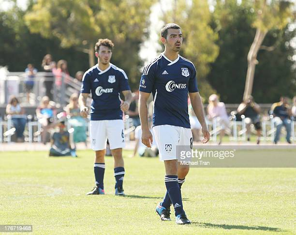 Kevin Jonas and Joe Jonas play soccer at The Jonas Brothers host a charity soccer match held at StubHub Center - track and field on August 17, 2013...
