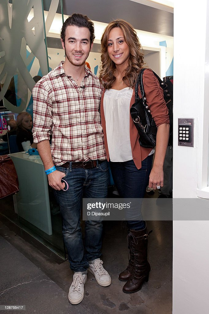 Kevin Jonas (L) and wife Danielle Deleasa attend the unveiling of the AOL media room at the Ronald McDonald House on October 7, 2011 in New York City.