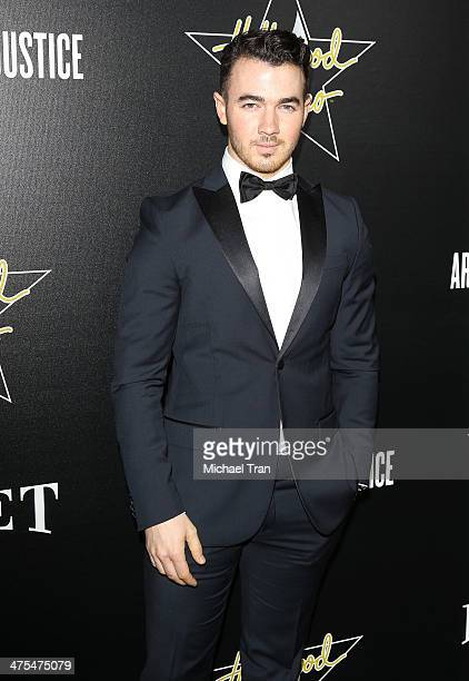Kevin Jonas arrives at the Hollywood Domino's 7th Annual PreOscar Charity Gala held at Sunset Tower on February 27 2014 in West Hollywood California