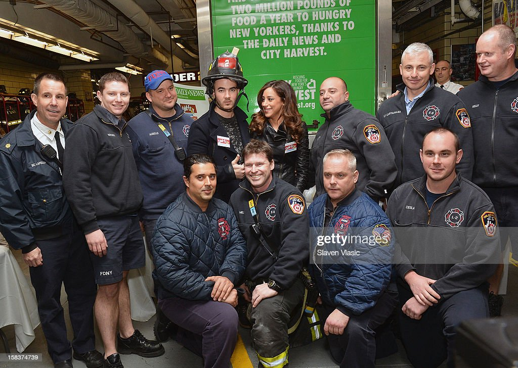 Kevin Jonas, Danielle Jonas and NYC Firefighters attend the Kevin Jonas, Danielle Jonas and City Harvest Holiday Season Food Drive at FDNY Station - Lexington & 3rd on December 14, 2012 in New York City.
