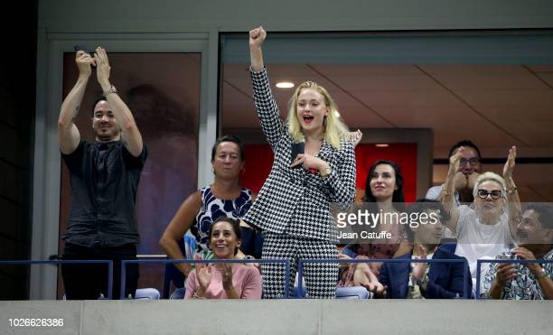 Kevin Jonas Danielle Jonas Joe Jonas and Sophie Turner attend the defeats of Maria Sharapova and Roger Federer on day 8 of the 2018 tennis US Open on...