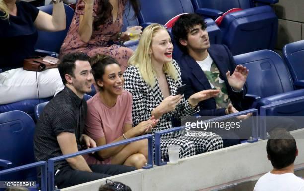 Kevin Jonas Danielle Jonas Joe Jonas Sophie Turner attend the defeats of Maria Sharapova and Roger Federer on day 8 of the 2018 tennis US Open on...