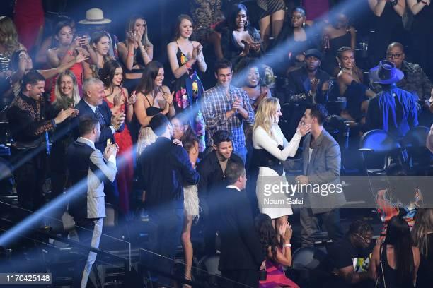 Kevin Jonas, Danielle Jonas, Nick Jonas, Sophie Turner and Joe Jonas celebrate award win in the audience during the 2019 MTV Video Music Awards at...
