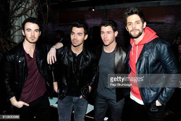 Kevin Jonas Joe Jonas and Nick Jonas and Thomas Rhett attend the John Varvatos Fall/Winter 2018 Show Front Row at The Angel Orensanz Foundation on...