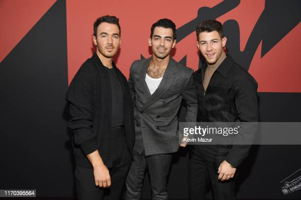 Kevin Jonas Joe Jonas and Nick Jonas attend the 2019 MTV Video Music Awards at Prudential Center on August 26 2019 in Newark New Jersey