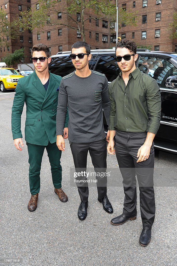 Kevin Jonas, Joe Jonas and Nick Jonas attend the Richard Chai Spring 2014 fashion show during Mercedes-Benz Fashion Week at The Stage at Lincoln Centeon September 5, 2013 in New York City.