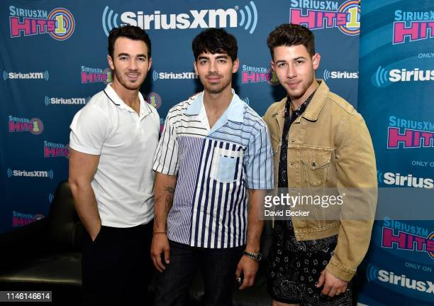 Kevin Jonas Joe Jonas and Nick Jonas attend the SiriusXM Hits 1 broadcast backstage at the Billboards Music Awards at MGM Grand Garden Arena on April...