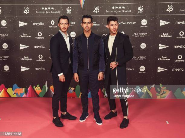 Kevin Jonas Joe Jonas and Nick Jonas of Jonas Brothers attend 'Los40 music awards 2019' photocall at Wizink Center on November 08 2019 in Madrid Spain