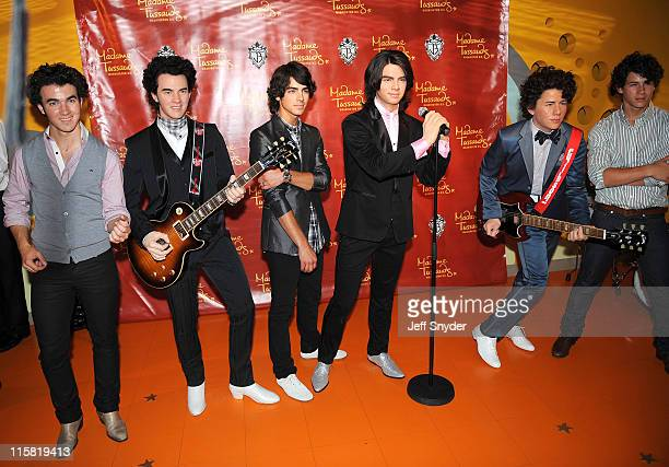 Kevin Jonas Joe Jonas and Nick Jonas of the Jonas Brothers at the unveiling of their wax figures at Madame Tussauds on August 18 2008 in Washington DC