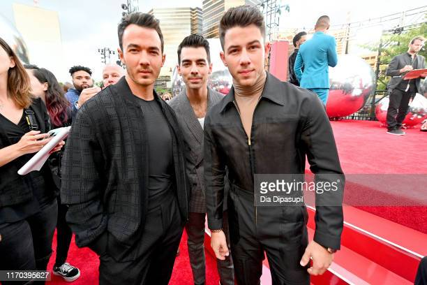 Kevin Jonas Joe Jonas and Nick Jonas of the Jonas Brothers attend the 2019 MTV Video Music Awards at Prudential Center on August 26 2019 in Newark...