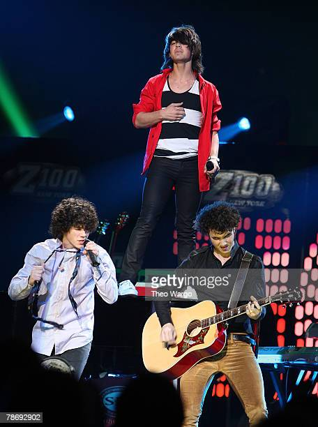 Kevin Jonas Joe Jonas and Nick Jonas of The Jonas Brothers on stage during Z100's Jingle Ball 2007 at Madison Square Garden on December 14 2007 in...