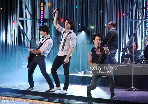 Kevin Jonas, Joe Jonas, and Nick Jonas of the Jonas Brothers perform during the Kristi Yamaguchi Friends and Family skating event at the US Airways...